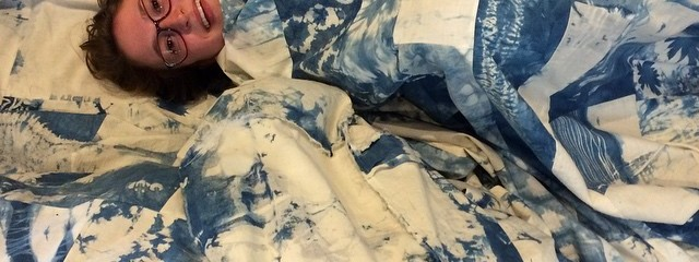 Katie and Molly swaddled in the Shibori quilt