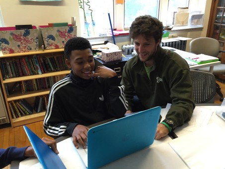 Nick Tutolo working with a student at the Environmental Charter School.