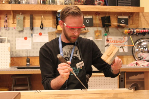 Colin uses a chisel to create a joint for the bookshelf.